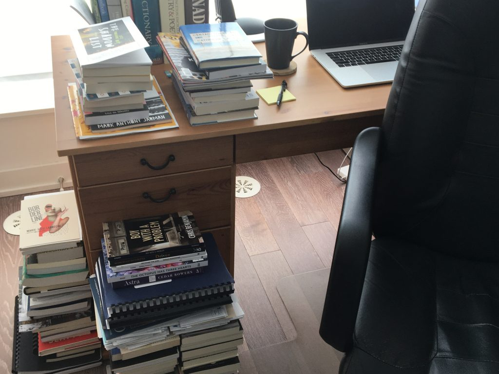 Desk with stacks of books