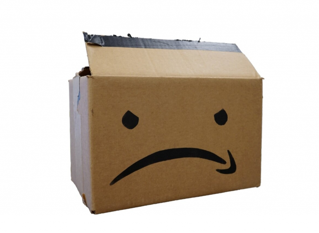 Amazon box with logo scowling