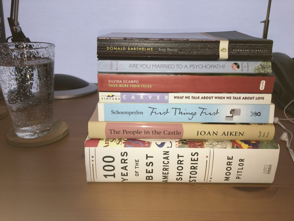 Stack of short fiction collections and anthologies