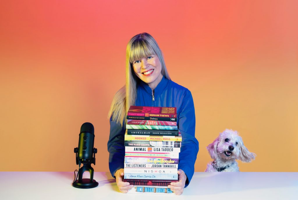 WordFest CEO Shelley Youngblut, with books and Clover the dog (Photo: Heather Saitz)